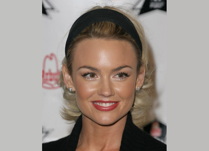 Kelly Carlson wearing her hair pulled back