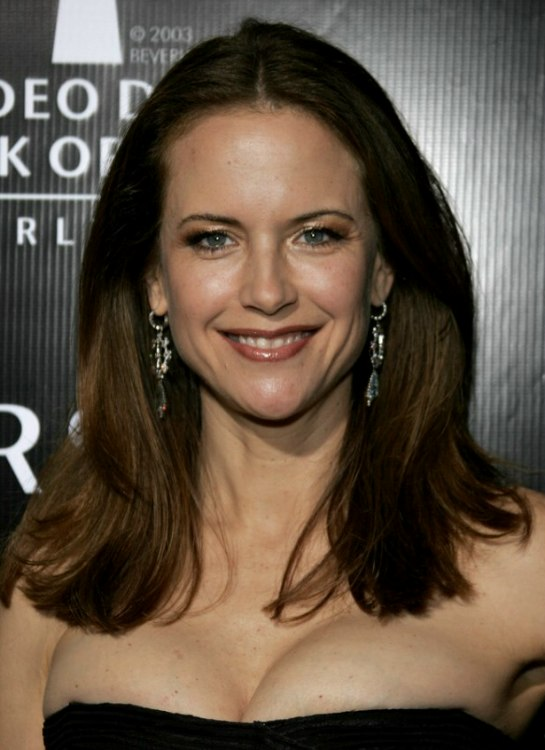 Kelly Preston Wearing Her Long Brunette Hair Cut Bluntly