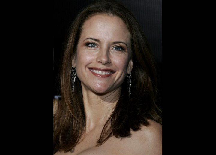 Kelly Preston's long hair styled with a flip