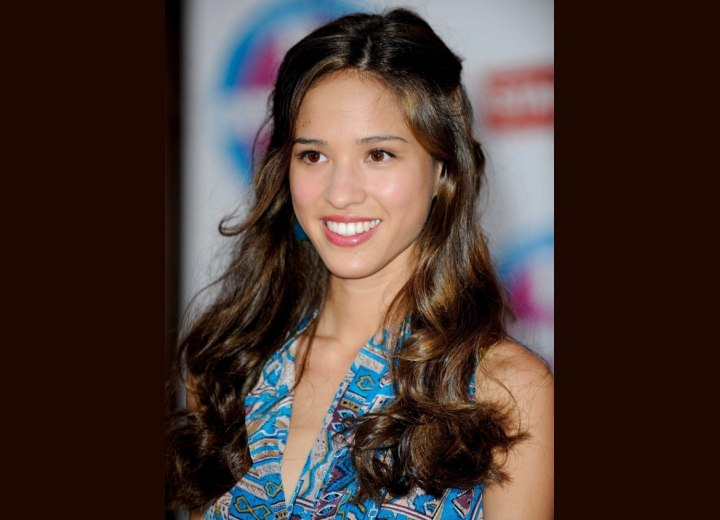 Kelsey Chow's long hair with curls and waves