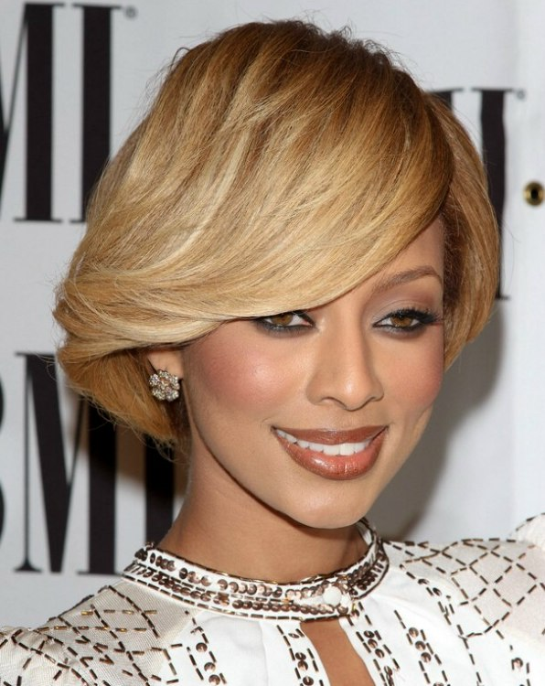 Keri Hilson sporting a short and glossy capped hairstyle Keri Hilson Hair Color
