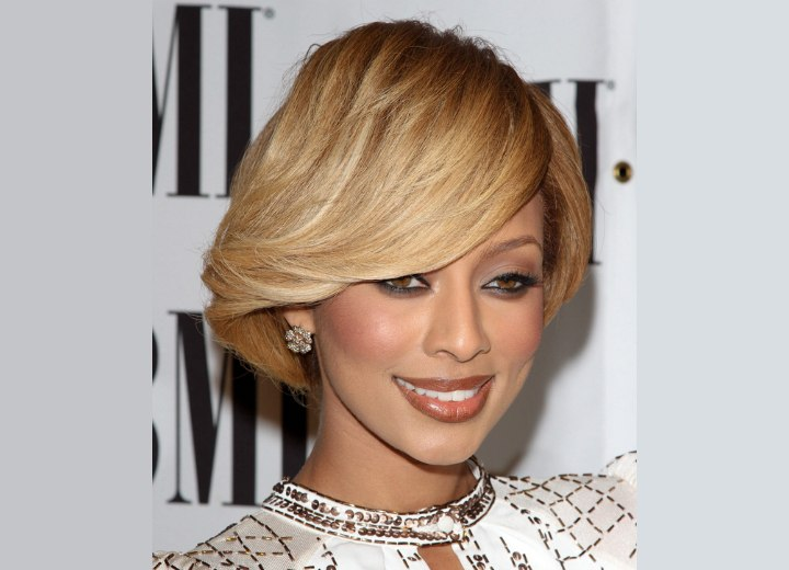 Keri Hilson's sleek hair with a dip over her eyebrow