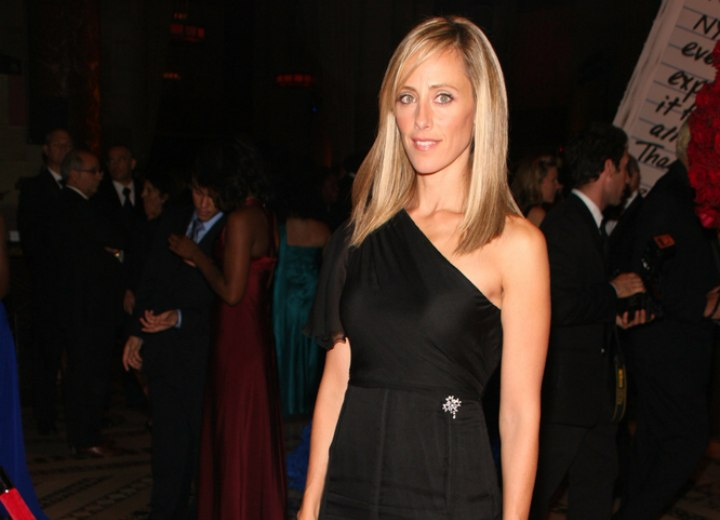 Kim Raver wearing a diagonal dress showing one shoulder