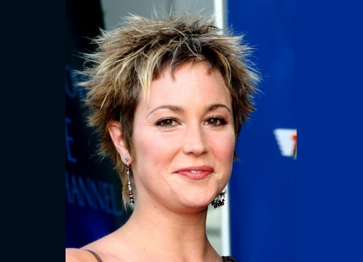 Kim Rhodes with her hair in a pixie