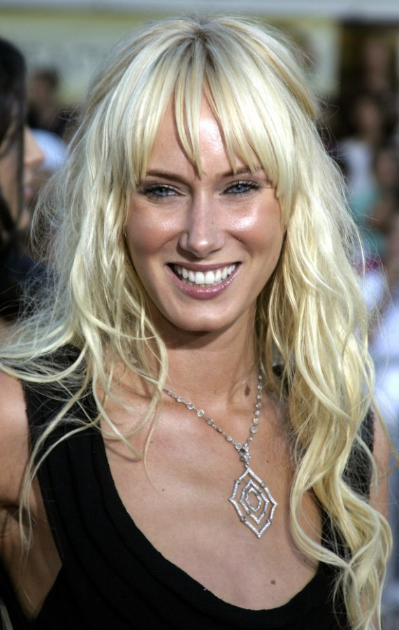 Kimberly Stewart Wearing Waist Long Hair With A Pinned