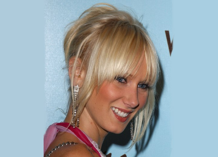 KImberly Stewart with her tapered hair styled up