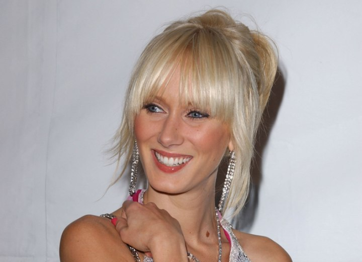 Kimberly Stewart's hair styled up with fringy strands