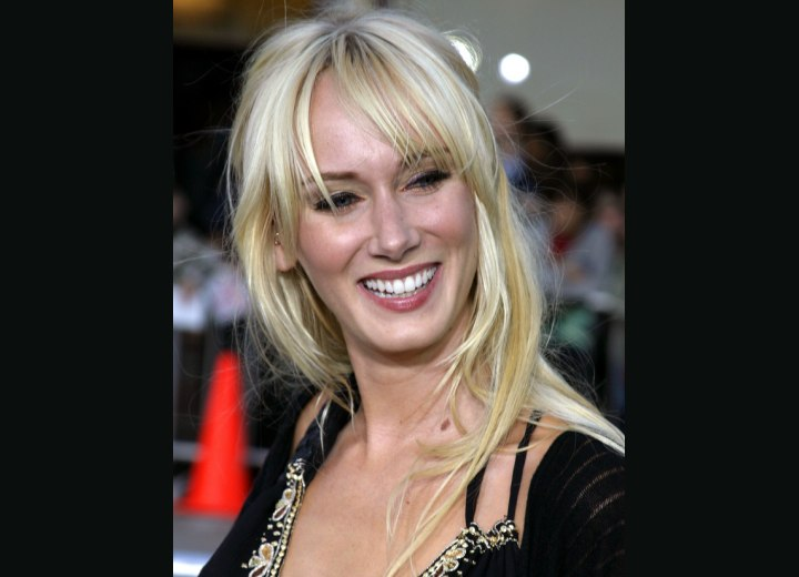 Kimberly Stewart's hair with long textured bangs