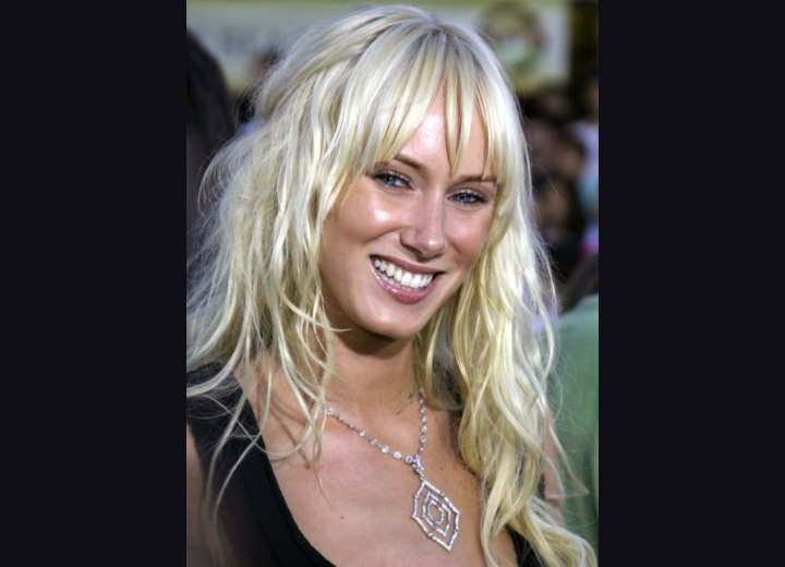 Kimberly Stewart with very long wavy hair