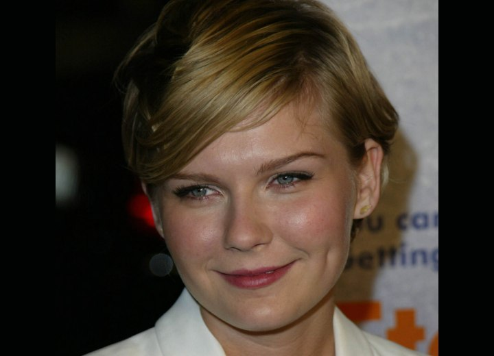 Kirsten Dunst's hair styled in a diagonal line
