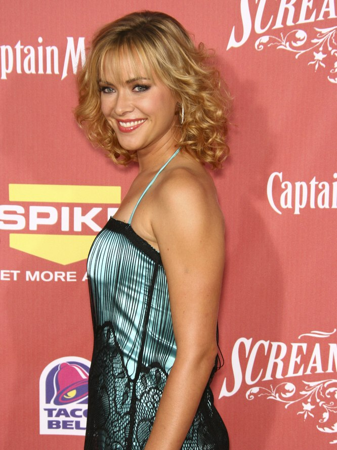 Kristanna Loken Wearing A Dress And Curls For A Retro