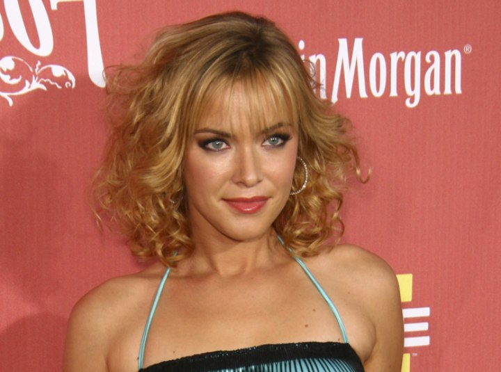 Kristanna Loken with curly shoulder length hair