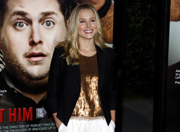 Kristen Bell's look with a shiny brown top and blazer