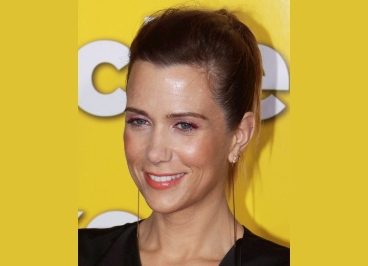 Kristen Wiig with her hair severely pulled back