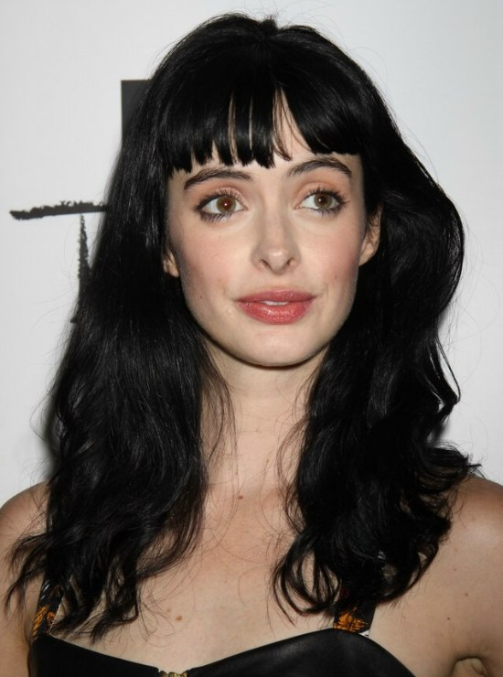 Krysten Ritter With Long Blue Black Hair And Short Bangs