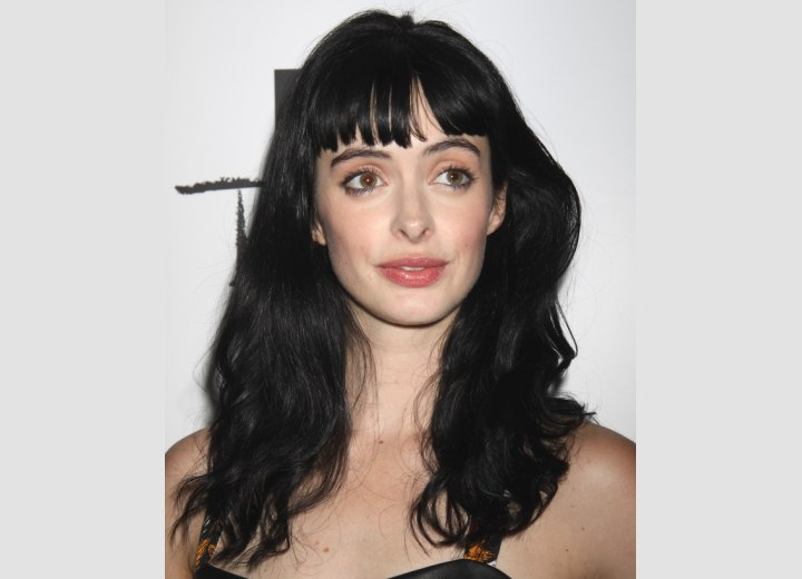 Krysten Ritter's long hair with ruffles on the ends