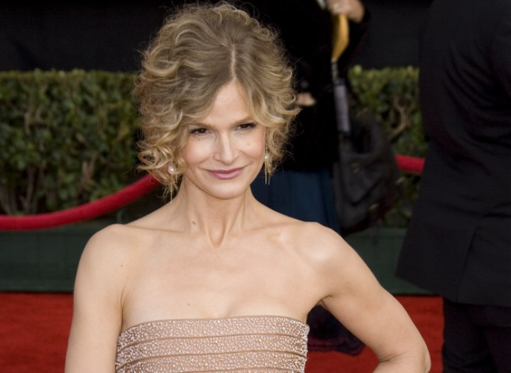 Kyra Sedgwick wearing her hair in an updo