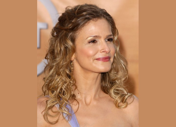 Kyra Sedgwick with long hair and curls