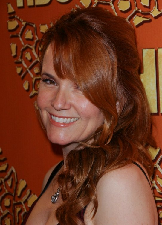 Lea Thompson With Her Long Red Hair Worn Over To One Side