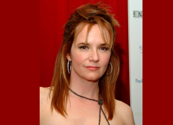 Lea Thompson's hairstyle with pieced sections