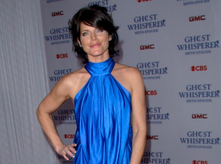 Lesli Kay wearing a shiny blue dress