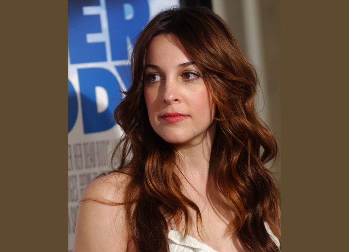 Lindsay Sloane's long curly hairstyle