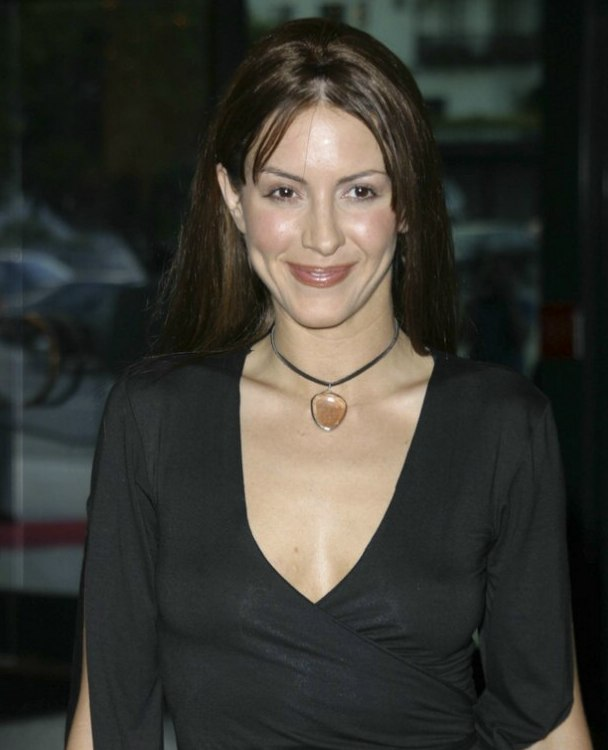 Michelle Clunie With Her Long Brown Hair Styled Straight