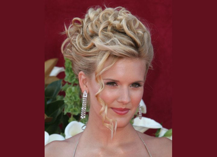 Maggie Grace's hair in an updo with tendrils around her face