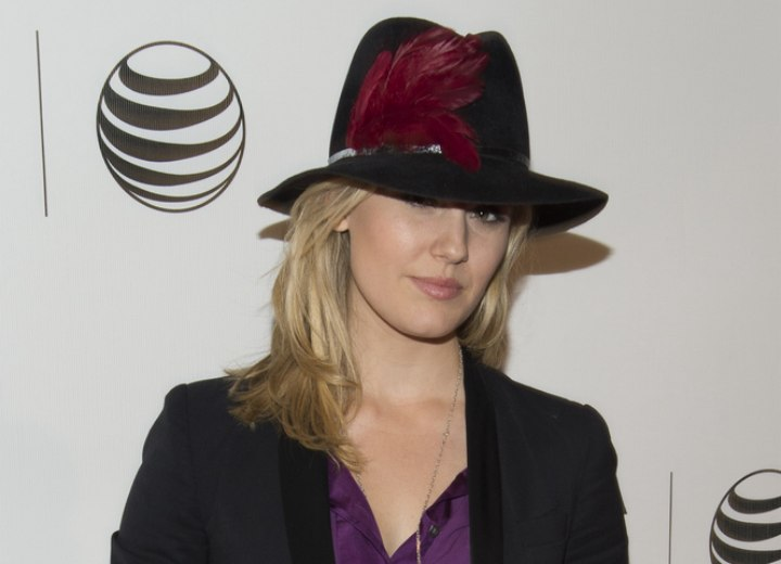 Maggie Grace's fun and fresh look with a hat