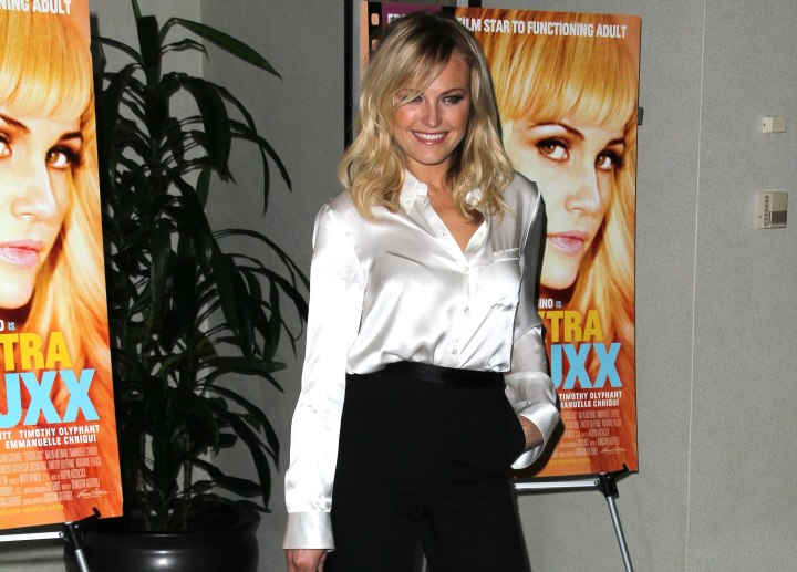 Malin Akerman professional look with satin blouse and high-waisted pants