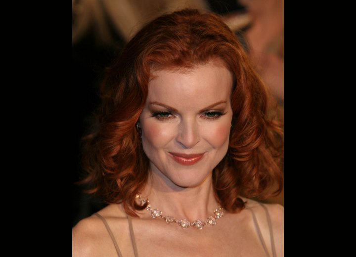 Medium length red hair with curls - Marcia Cross