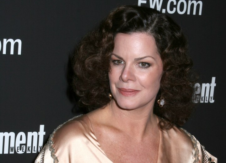 Marcia Gay Harden with mid length curly hair