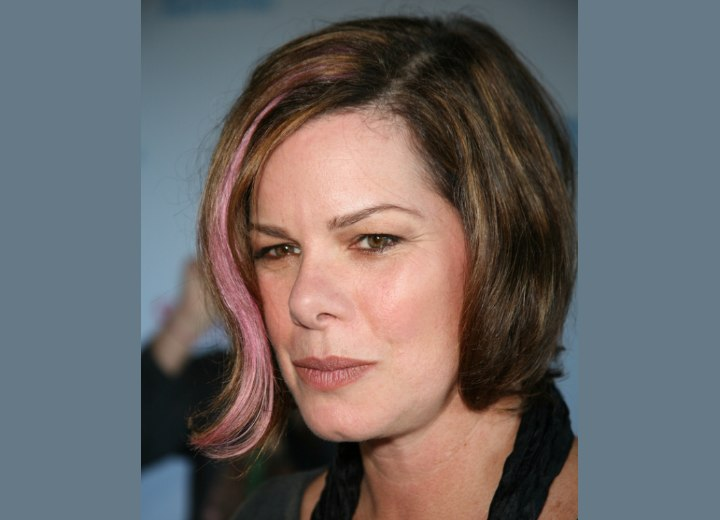 Hair with a pink strand - Marcia Gay Harden