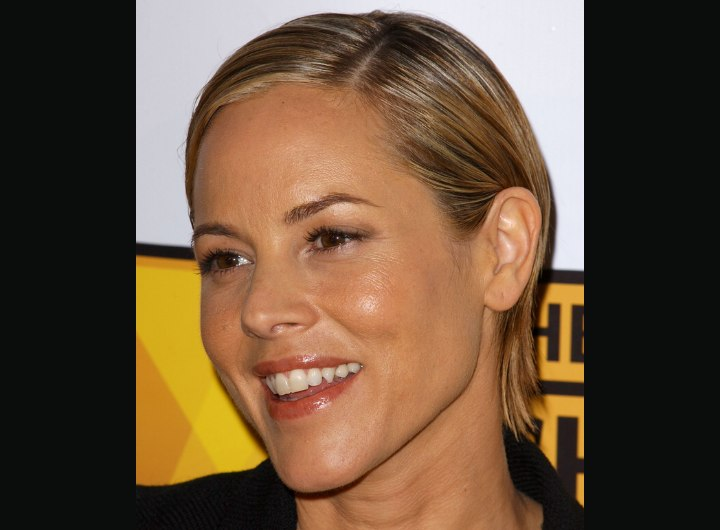 Maria Bello's side parted short hairstyle