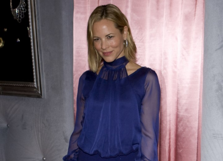 Maria Bello wearing a blue silk blouse with sheer sleeves