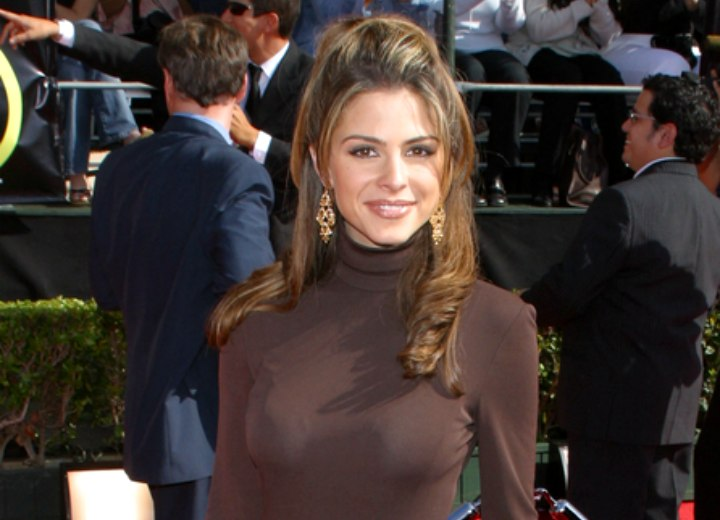 Maria Menounos wearing a tight turtleneck dress