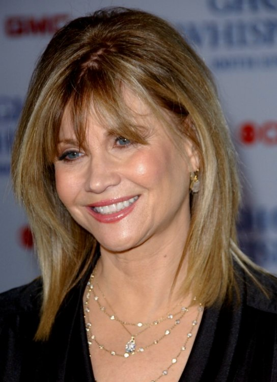 Markie Post S Hair With Layers That Rests Upon Her Shoulders