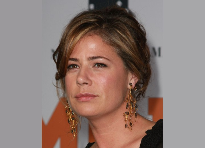 Maura Tierney wearing her hair in an updo