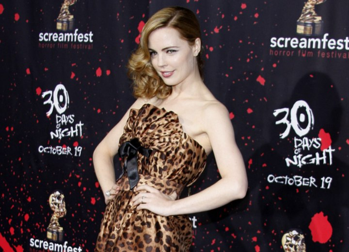 Melissa George wearing a strapless leopard print dress