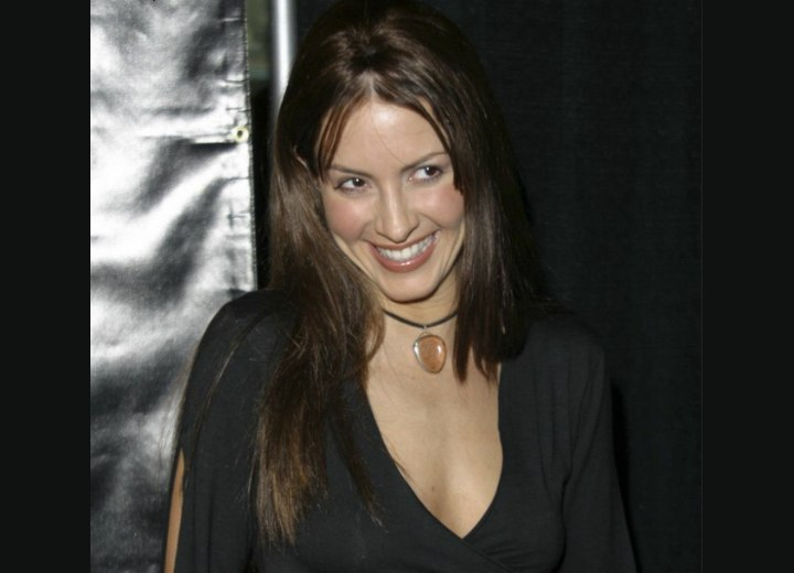 Michelle Clunie with long brown hair