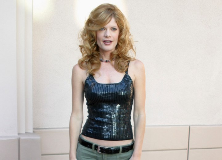 Michelle Stafford wearing a black sequined top