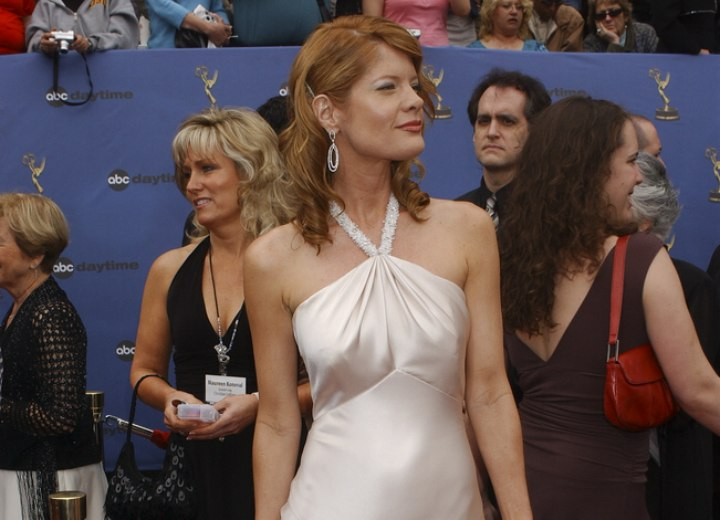 Michelle Stafford wearing a mother of pearl color dress