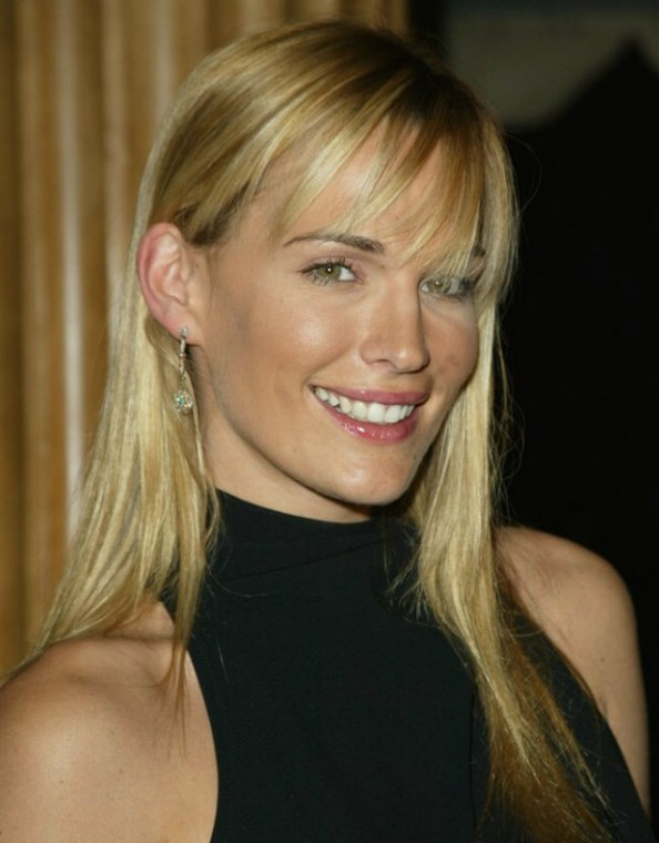 Molly Sims With Her Long Hair In An Open Style And Wearing
