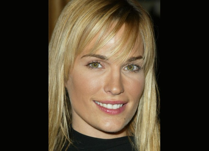 Close up photo of Molly Sims hair with bangs