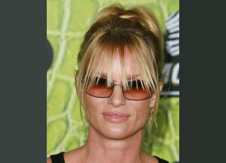 Nicollette Sheridan's hair with long piecy bangs