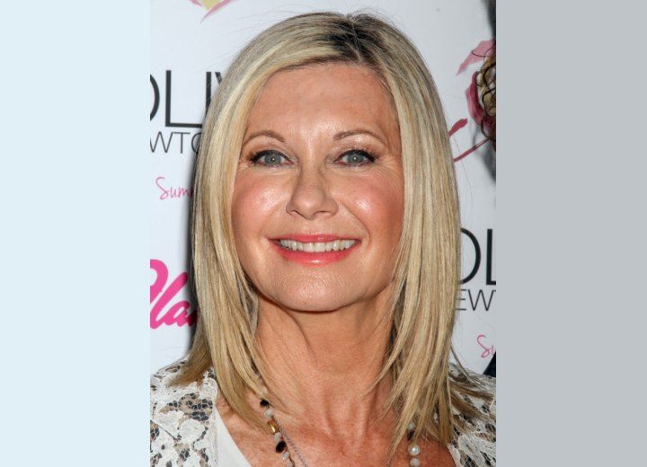 Olivia Newton John's smooth shoulder length hairstyle