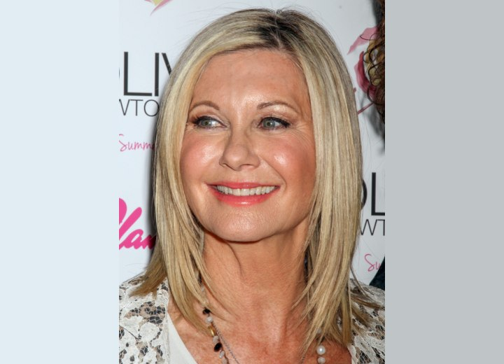 65 plus Olivia Newton John with a timeless hairstyle
