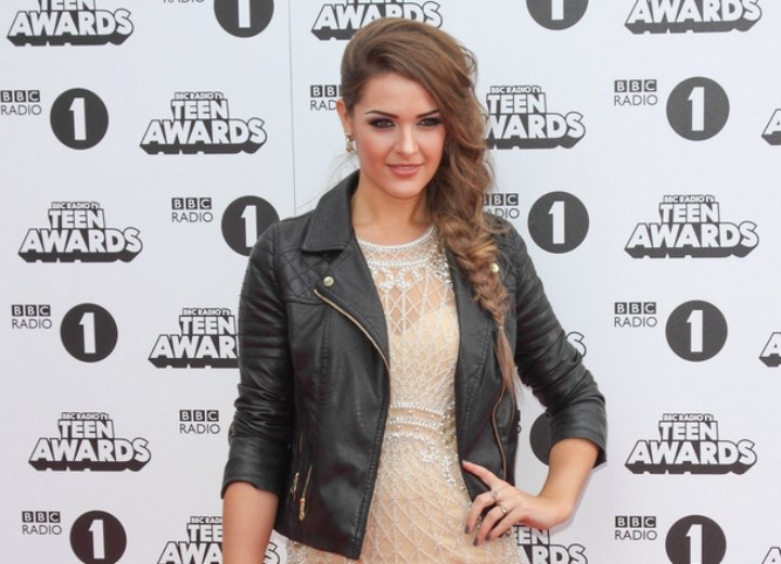 Anna Passey with her hair in a side braid