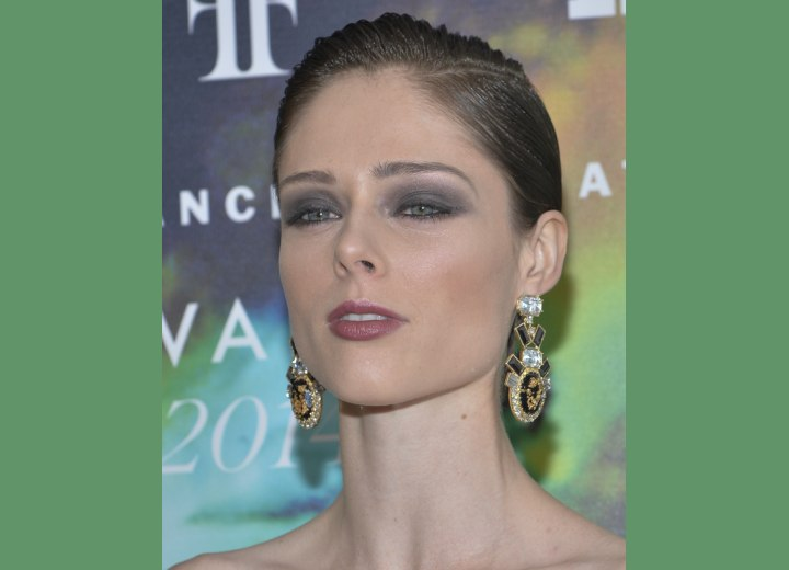 Coco Rocha with slicked back hair