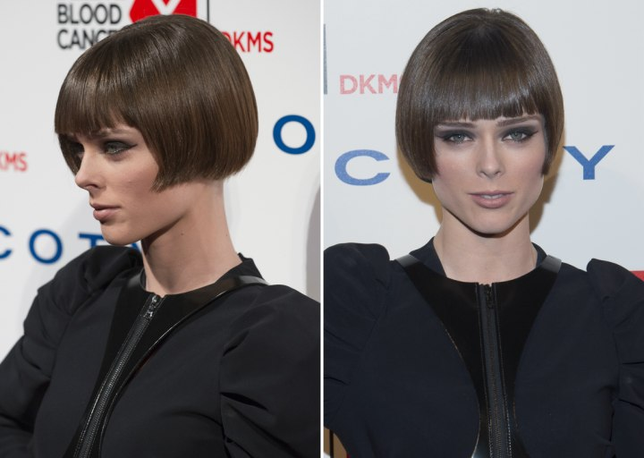Coco Rocha with short hair that angles straight back